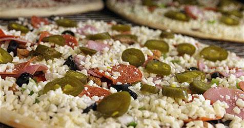 Pizzabote wehrt sich bei Überfall mit Pizza