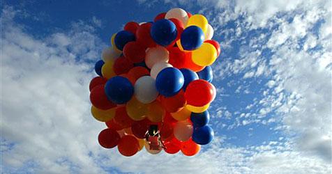 Luftballons tragen Amerikaner 380 Kilometer weit