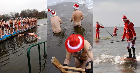 Unerschrockene gönnen sich eisiges Weihnachts-Bad