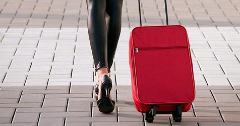So packst du deine Koffer richtig und sicher (Bild: © 2010 Photos.com, a division of Getty Images)