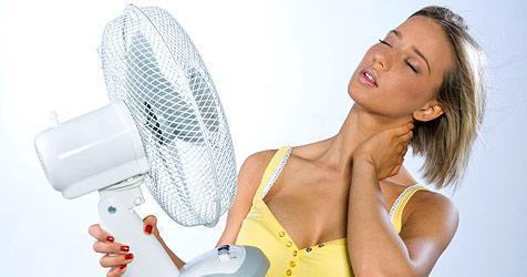 Unklarheit über Hitze-Kleidung im Büroalltag (Bild: © 2010 Photos.com, a division of Getty Images)