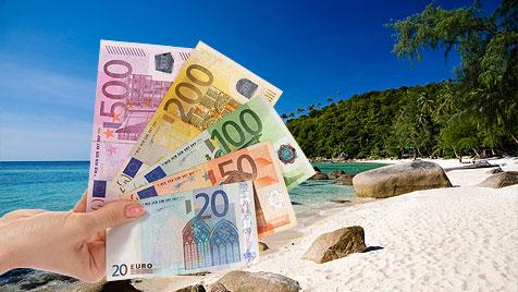 Knapp bei Kasse? Urlaub trotz Ebbe in der Brieftasche (Bild: © 2011 Photos.com, a division of Getty Images)