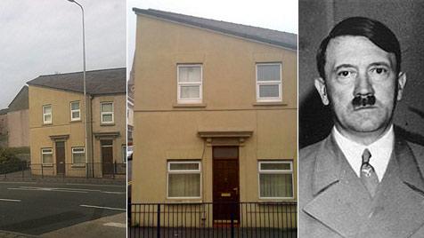 Britische Hausfront sieht aus wie Nazi-Diktator Adolf Hitler (Bild: AP, Charli Dickenson)