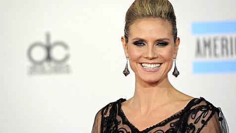 Heidi Klum litt früher beim Lächeln für Modekataloge (Bild: AP)