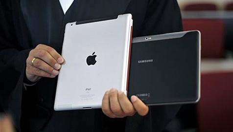 Apple und Samsung wollen Kriegsbeil begraben (Bild: AP)