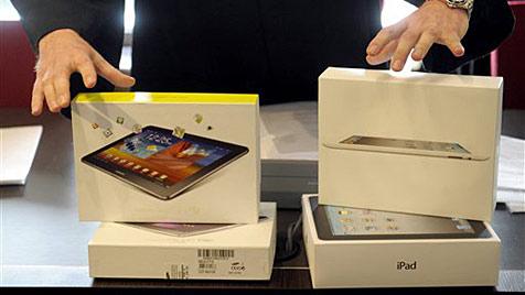 Samsung und Apple suchen nach Lösung in Patentstreit (Bild: AP)