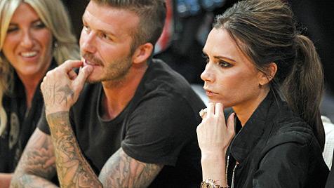 Victoria und David Beckham von Kiss-Cam erwischt (Bild: AP)