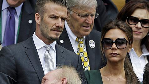 David und Victoria Beckham wollen Olympia-Baby (Bild: AP)