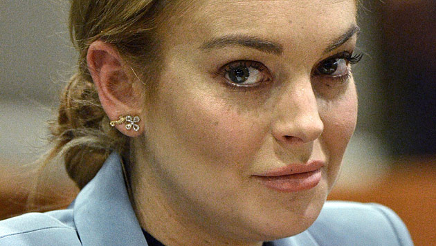 Lindsay Lohan spielt Festnahme herunter (Bild: dapd)