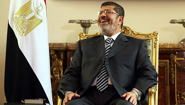 """Von """"Blutsaugern"""" und """"Affen"""": Mursi wiegelt ab (Bild: EPA)"""
