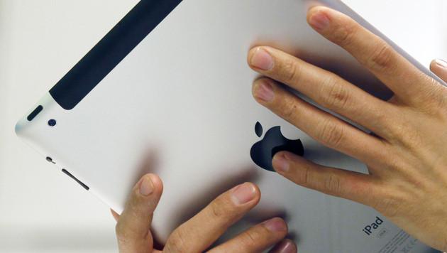 50.000 gefälschte Handys und iPads beschlagnahmt (Bild: AP)