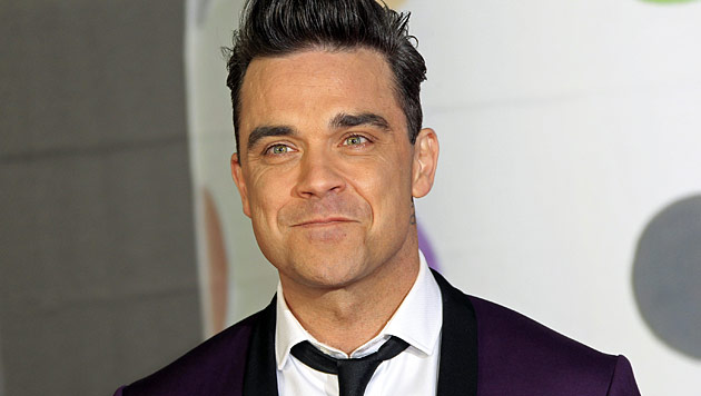 Robbie Williams muss zum Mutter-Kind-Kurs (Bild: AP)