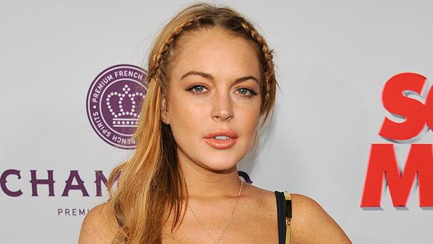 Lindsay Lohan muss weiterhin zur Therapie gehen (Bild: EPA)