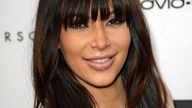 Kim Kardashian will erstes Foto von Tochter verkaufen (Bild: AP)
