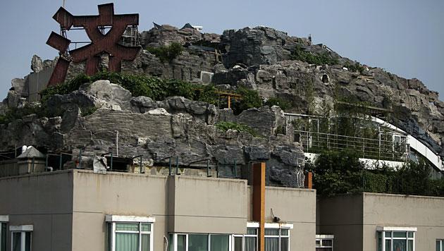 """""""Felsenvilla"""" auf Hochhaus muss abgerissen werden (Bild: EPA)"""