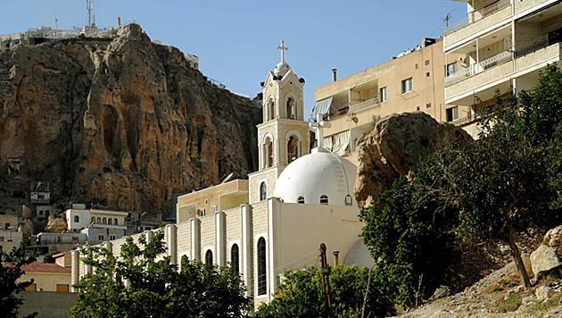 Syrische Rebellen zwingen Christen zum Islam (Bild: AP)