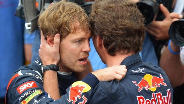 """Champion Vettel schwört den """"Bullen"""" Treue (Bild: EPA)"""