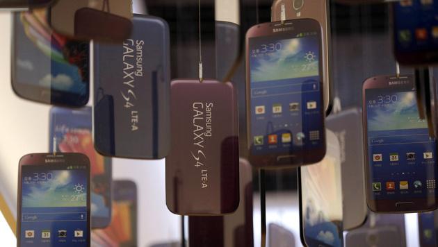 Smartphones setzen weltweiten Siegeszug fort (Bild: AP)
