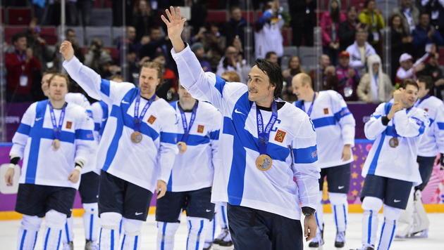 Finnen demütigen im kleinen Finale USA mit 5:0 (Bild: APA/EPA/LARRY W. SMITH)