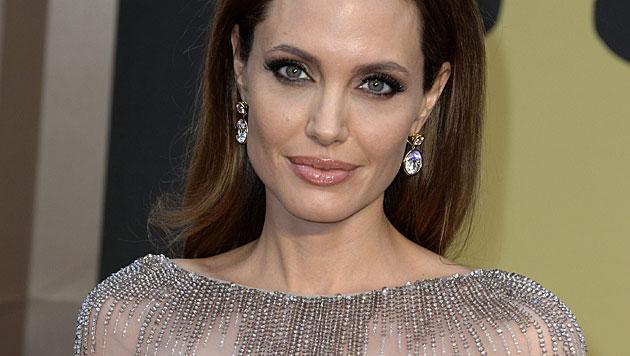 Hier stiehlt Vivienne Mama Angelina Jolie die Show (Bild: APA/EPA/MIKE NELSON)
