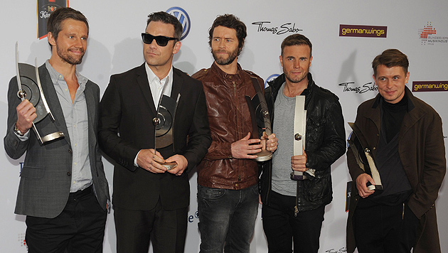 Seit 2005 ist die Band wieder gemeinsam unterwegs. 2010 gesellte sich auch Robbie Williams dazu. (Bild: JOERG CARSTENSEN/EPA/picturedesk.com)