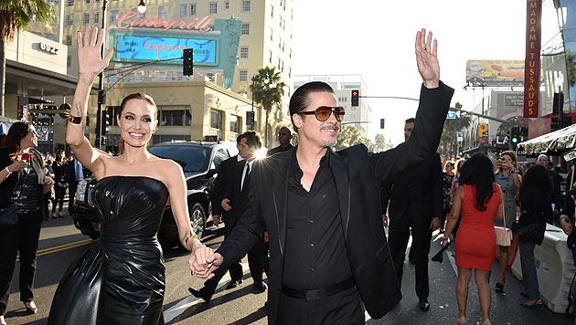 """Brad Pitt und Angelina Jolie bei der Filmpremiere von """"Maleficent"""" (Bild: John Shearer/Invision/AP, Matt Sayles/Invision/AP)"""