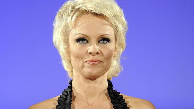Pamela Anderson (Bild: APA/EPA/CLAUDIO ONORATI)