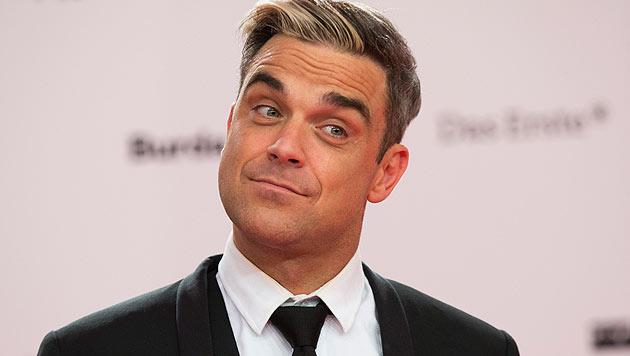 Robbie Williams im Anflug auf Velden am Wörthersee (Bild: AP)