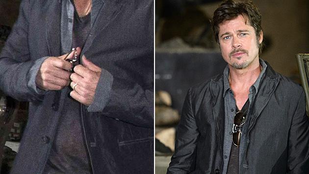 """Bei einem Fototermin für den Film """"Fury"""" zeigte Brad Pitt bereits seinen Ehering. (Bild: AP, AFP)"""