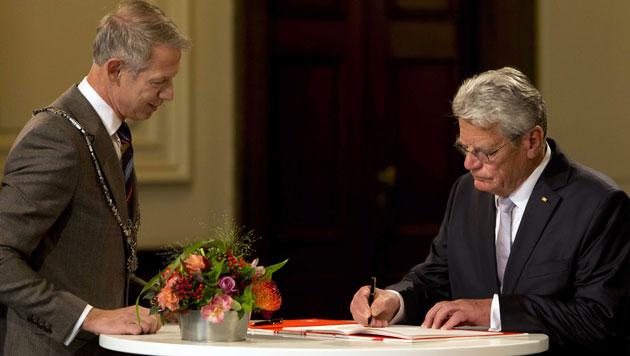 ... und der deutsche Präsident Joachim Gauck. (Bild: EPA)
