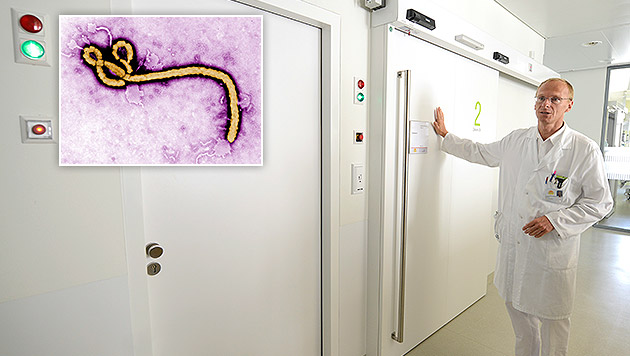 Chefmediziner Christoph Wenisch auf der Isolierstation des Kaiser-Franz-Josef-Spitals in Wien (Bild: APA/HELMUT FOHRINGER, APA/EPA/Frederick A. Murphy)