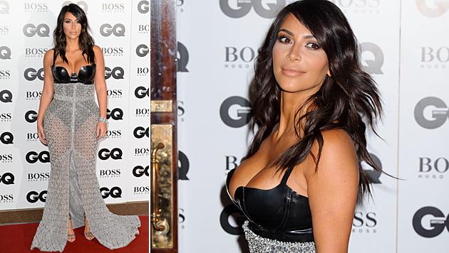 Kim Kardashian presst sich in Domina-Kleid (Bild: Jonathan Short/Invision/AP)