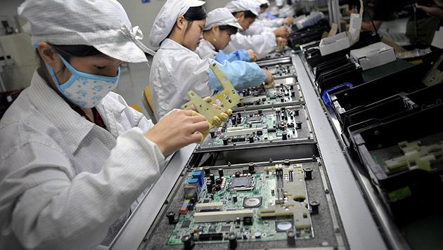 Arbeitskosten verdoppelt: Foxconn baut Stellen ab (Bild: AFP)
