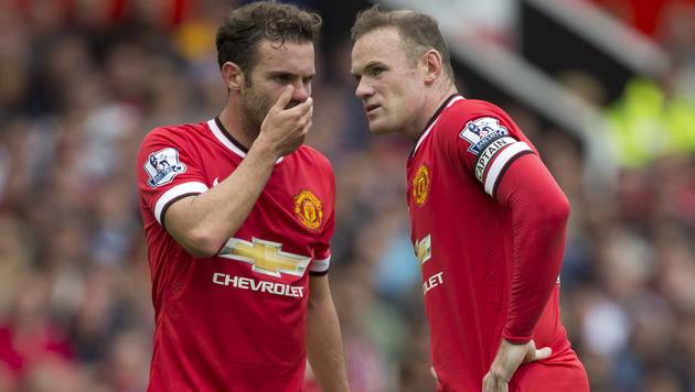 Ratos: Die ManU-Spieler Juan Mata (links) und Wayne Rooney grübeln. (Bild: AP)