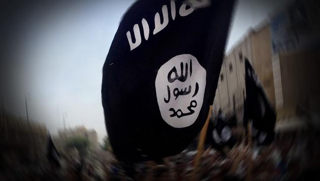 IS-Flagge als Profilbild: Sechs Monate bedingt (Bild: AP, krone.at-Grafik (Symbolbild))
