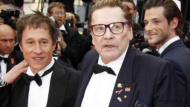 Helmut Berger mit Regisseur Bertrand Bonello in Cannes. (Bild: APA/EPA/SEBASTIEN NOGIER)