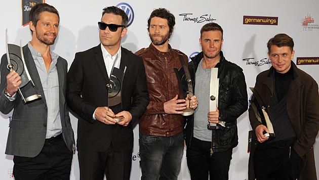 Robbie Williams ist wieder dabei, Jason Orange (ganz links) steigt bei Take That aus. (Bild: JOERG CARSTENSEN/EPA/picturedesk.com)