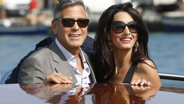 George Clooney und Amal Alamuddin bei ihrer Ankunft in Venedig (Bild: AP)