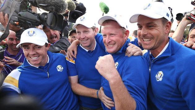 Rory McIlroy, Stephen Gallacher, Jamie Donaldson und Henrik Stenson jubeln (Bild: AP)