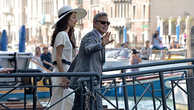 George Clooney und Amal (Bild: AP)