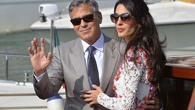 George und Amal Clooney bei den Hochzeitsfeierlichkeiten in Venedig (Bild: AFP)