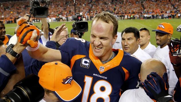NFL-Star Manning setzt Karriere in Denver fort (Bild: AP/Jack Dempsey)