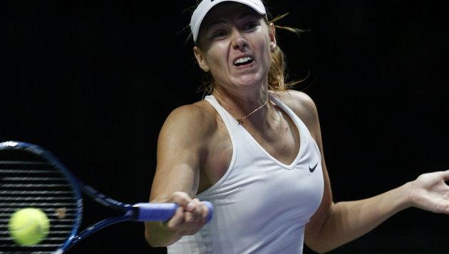 Wozniacki gewinnt Tennis-Marathon gegen Scharapowa (Bild: APA/EPA/WALLACE WOON)