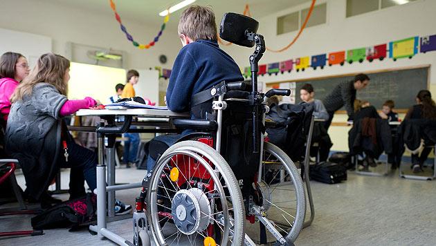 Pflege: Verbesserung für Eltern behinderter Kinder (Bild: dpa/Uwe Anspach)