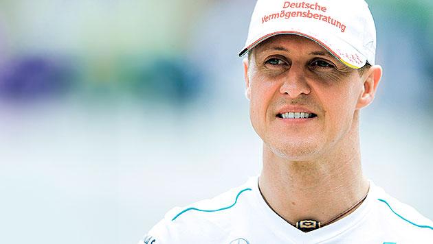 Sponsoren bleiben Michael Schumacher weiter treu! (Bild: APA/EPA/DIEGO AZUBEL, krone.at-Grafik)