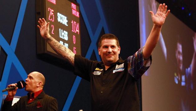 Party ist vorbei: Anderson neuer Darts-Weltmeister (Bild: APA/EPA/SEAN DEMPSEY)