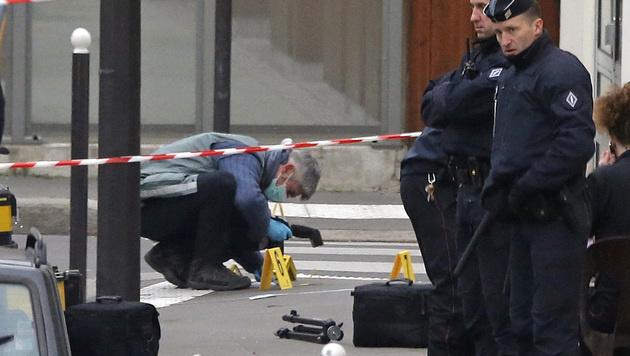 88.000 Polizisten jagen die Terrorbrüder (Bild: AP)
