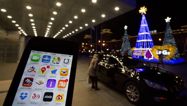 China verbannt private Uber-Fahrer von den Straßen (Bild: AP)