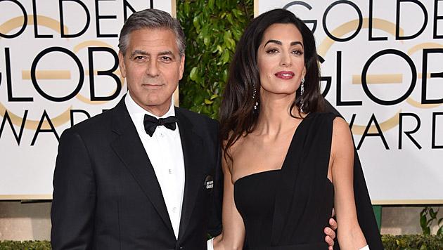 George Clooney und seine Amal (Bild: John Shearer/Invision/AP)