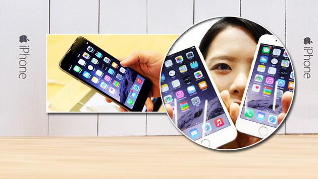 iPhone 6 beschert Apple ein Rekord-Quartal (Bild: AP,APA/EPA/PETER KNEFFEL, APA/EPA/PAUL ZINKEN)